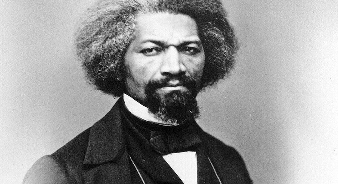 Frederick Douglass posing for photo