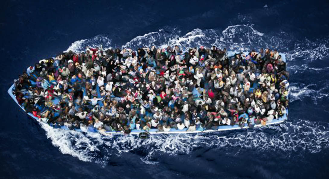 several people on a crowded boat in the ocean