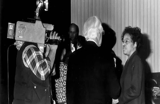 man interviewing woman in front of a camera