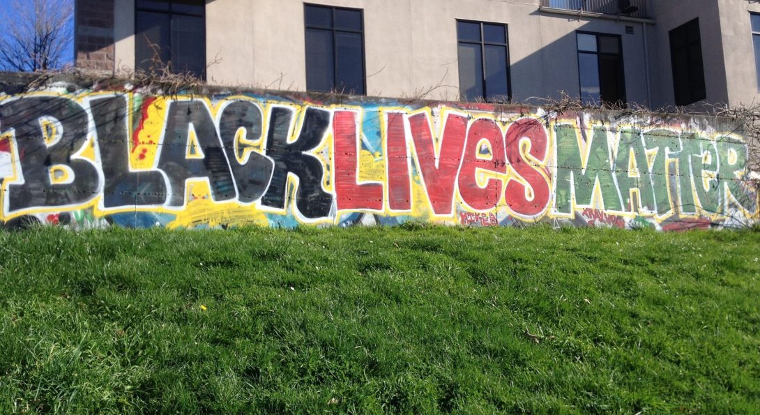 a mural on a wall that reads black lives matter