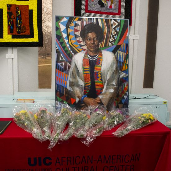 image of Grace Holt mural on a table with flowers at award ceremony