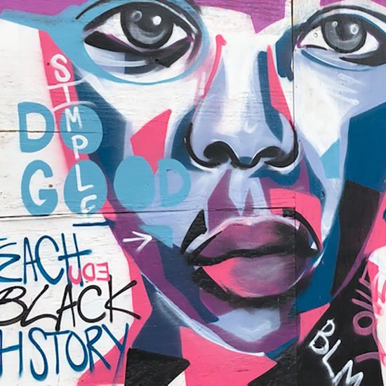 Painted mural that reads Teach Black History