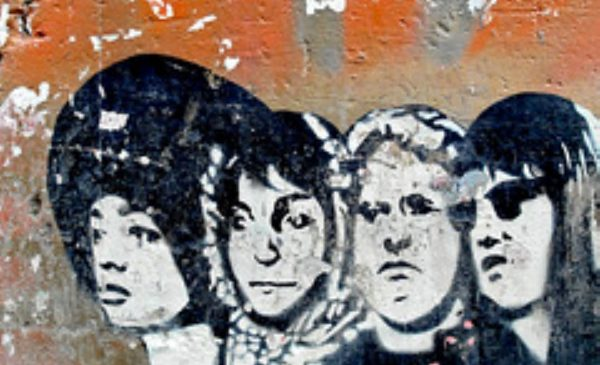a mural on a deteriorating wall of revolutionary women