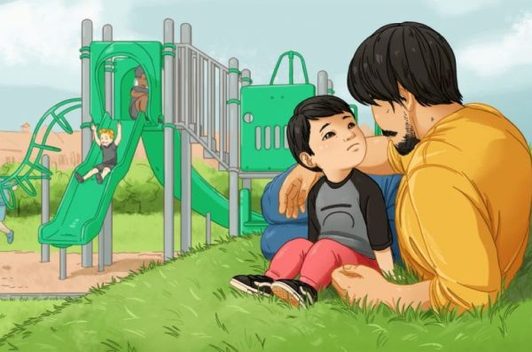 A father speaks to his child in front of a playground