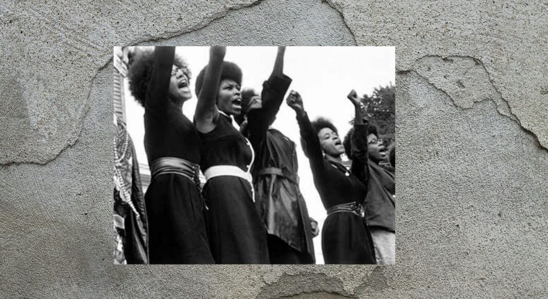 women of the black panthers raise their fists in the air